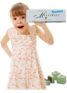 Girl smiling with box of candy