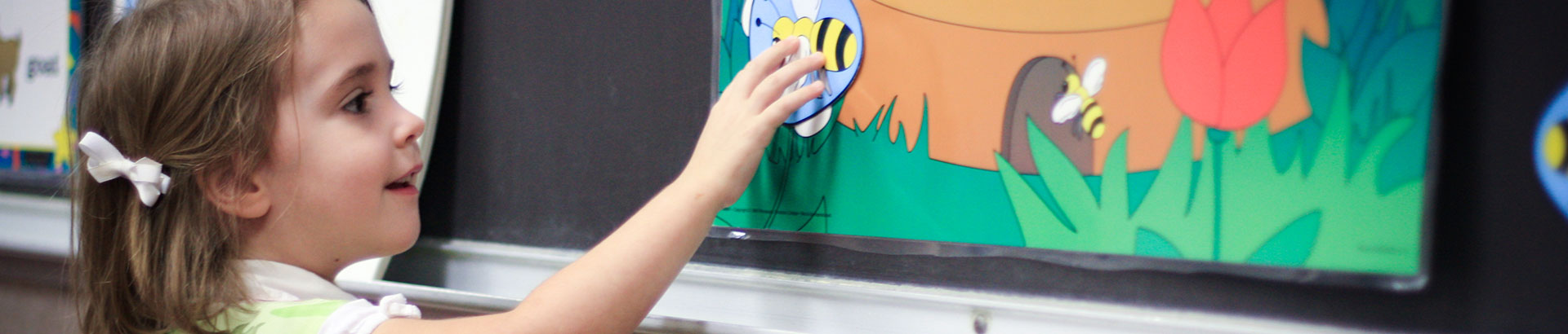 Girl Student Adding Bee to Her Artwork